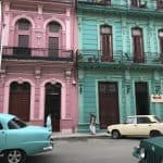 Antique cars and colorful buildings in Havana, Cuba